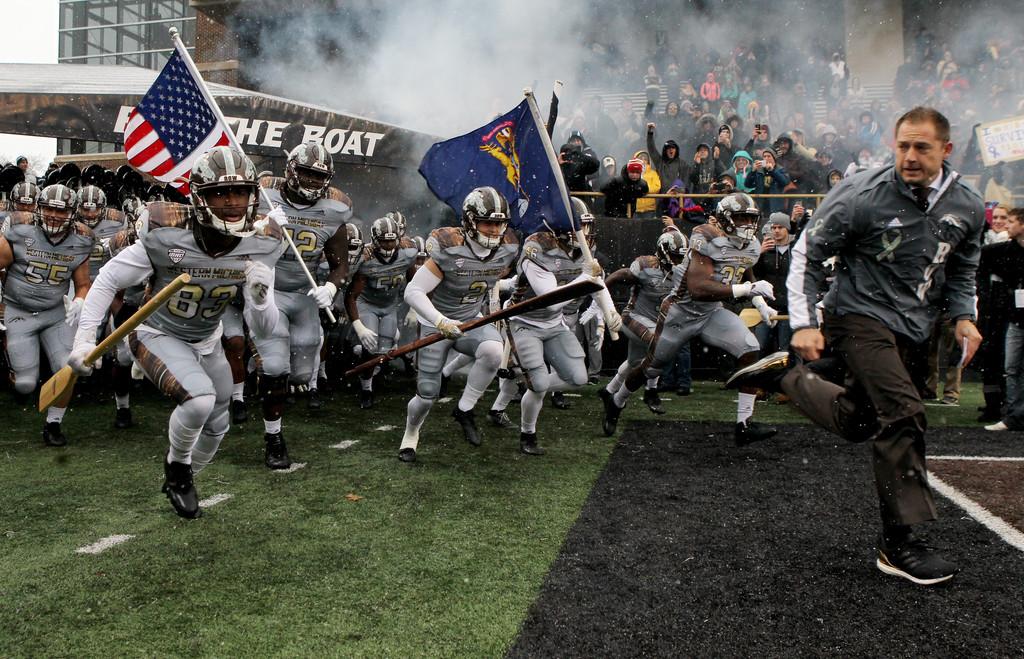 Western Michigan Broncos head coach P.J. Fleck leads his team onto the field against the Buffalo Bulls