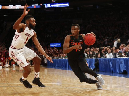 Deandre Burnett, then with the Miami (Fla.) Hurricanes, goes to the basket against Temple Owls' Josh Brown in March 2015 (Getty Images)