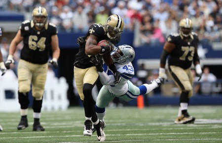 Gerald Sensabaugh Jr., Cowboys safety, tries to tackle New Orleans Saints wide receiver Marques Colton (Getty Images)