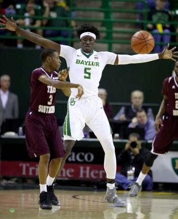 Johnathan Motley playing defense (Getty Images)