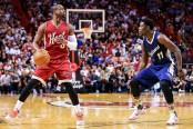 New Orleans Pelicans guard Jrue Holiday guarding Miami Heat star Dwyane Wade