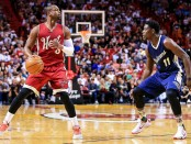 New Orleans Pelicans guard Jrue Holiday guarding Miami Heat star Dwyane Wade