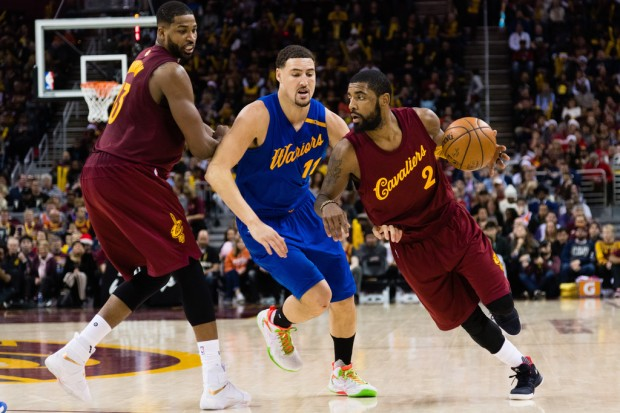 Golden State Warriors star Klay Thompson guarding Cleveland Cavaliers star Kyrie Irving
