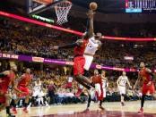 Cleveland Cavaliers superstar LeBron James shoots over Atlanta Hawks forward Paul Millsap