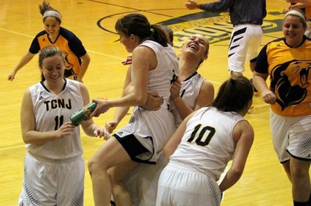 Lions celebrate their win over No. 8/11 Montclair State Red Hawks (Photo by TCNJ Sports Information Department)
