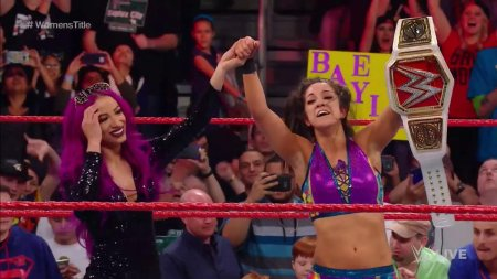 Sasha Banks celebrates with Bayley after she became the new WWE Women's Champion (Photo by the WWE)
