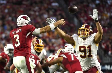 Carson Palmer throws a pass against the Washington Redskins