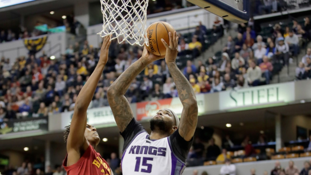 Former Sacramento Kings center DeMarcus Cousins attempts to score against the Indiana Pacers