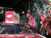 Lilly Diabetes Ford driver Ryan Reed celebrates his win in Victory Lane after winning the PowerShares QQQ 300
