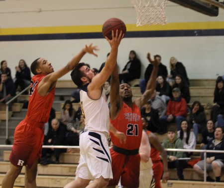 Eric Klacik going up for a layup (Photo by John Marshall)