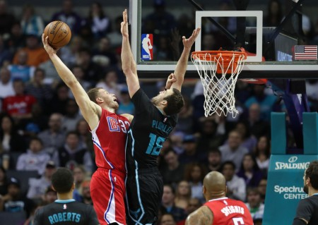 Miles Plumlee tries to block Blake Griffin's shot (Getty Images)