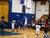 Trenton Catholic Academy's Chris LaBelle shooting a three-pointer (Photo by John Marshall)