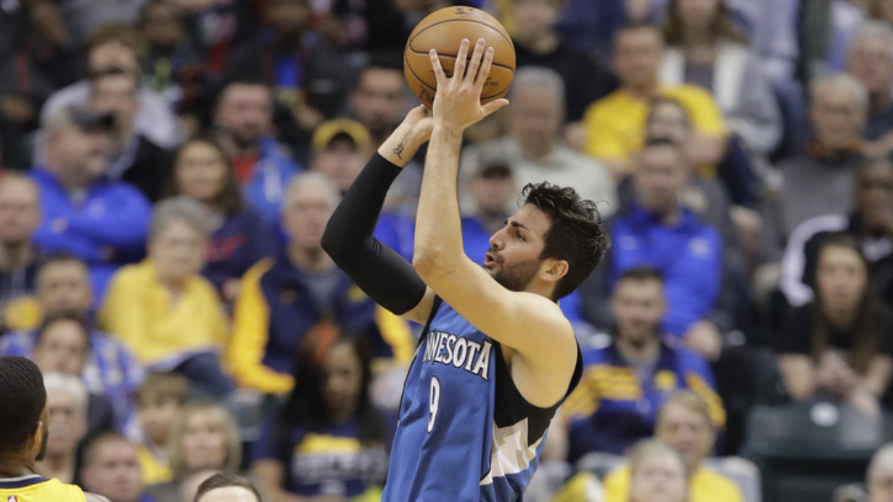 Minnesota Timberwolves point guard Ricky Rubio attempts to shoot the ball against the Indiana Pacers