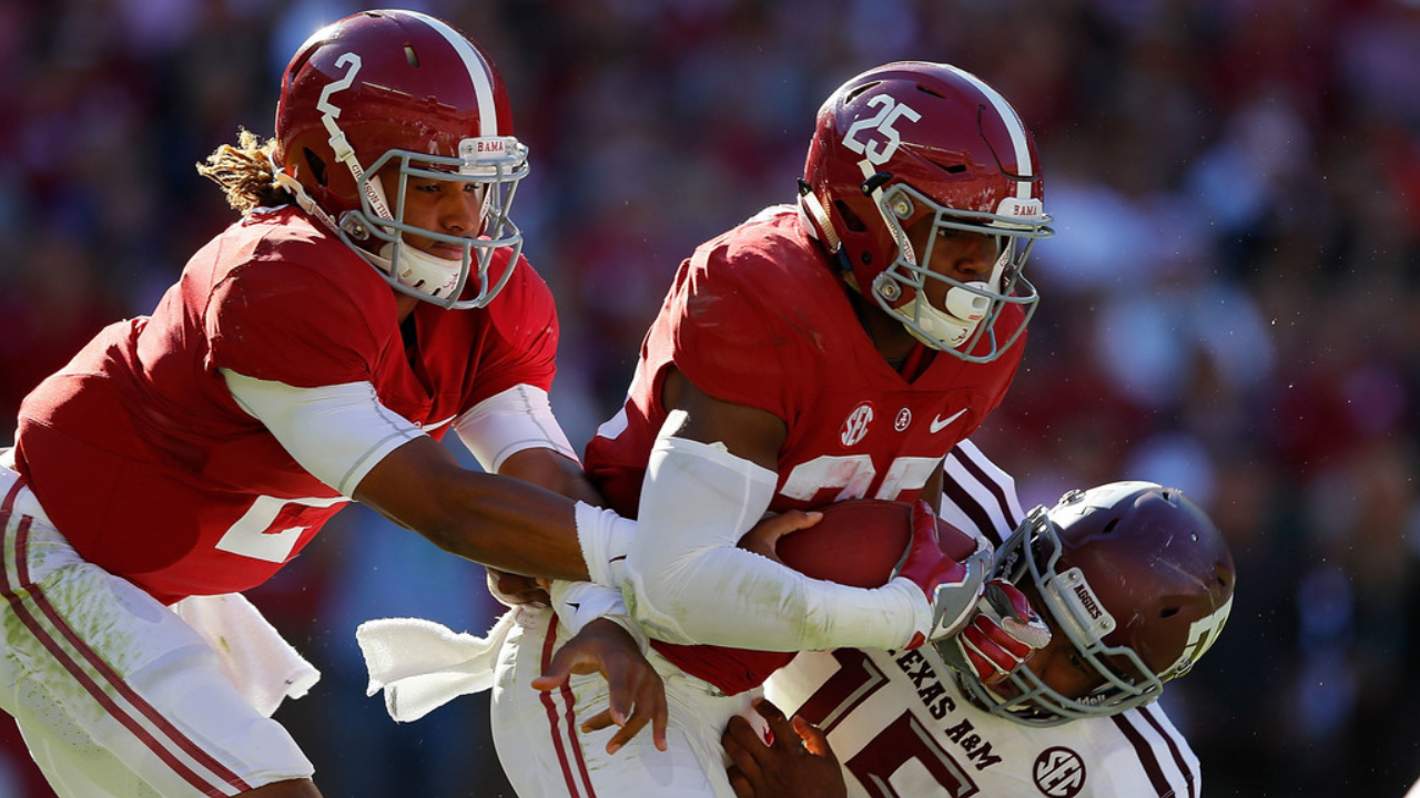 Former Texas A&M Aggies star defensive end Myles Garrett tackles Joshua Jacobs against the Alabama Crimson Tide as he takes a handoff from Jalen Hurts