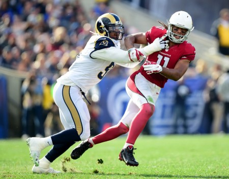 Dominique Easley trying to tackle Larry Fitzgerald (Getty Images)