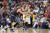 Paul George fends off Kevin Love (Getty Images)
