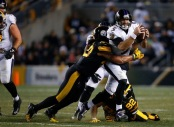 Ravens quarterback Joe Flacco being tackled by a Pittsburgh Steelers player (Getty Images)