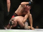 Alexey Oleynik punching Travis Browne (Getty Images)