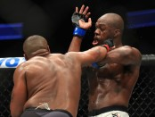 Daniel Cormier punching Jon Jones to the face at UFC 214 (Getty Images)