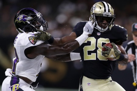 Terrence Brooks, as a member of the Ravens, tries to tackle New Orleans Saints running back C.J. Spiller (Getty Images)