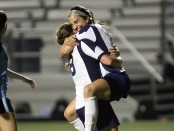 Christine Levering and a teammate celebrate after her game-winning goal (Photo by the TCNJ Sports Information Department)