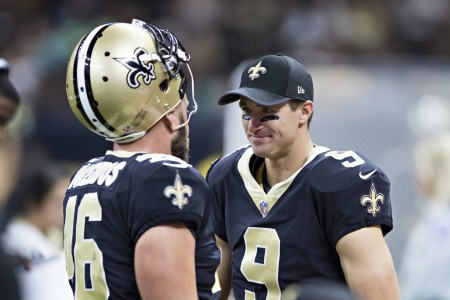 Jon Dorenbos talking to Drew Brees (Getty Images)