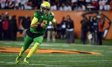 Oregon quarterback Marcus Mariota running the ball against the Oregon State Beavers