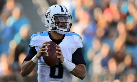 Tennessee Titans quarterback Marcus Mariota getting ready to throw a football against the Jacksonville Jaguars