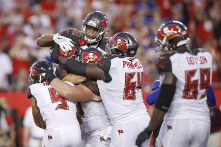 Tampa Bay Buccaneers kicker Nick Folk being mobbed by his teammates after his game-winning field goal against the New York Giants (Getty Images)