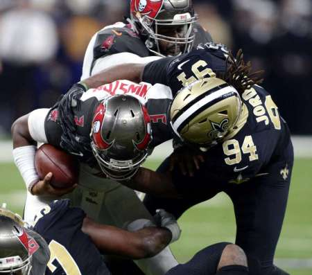 Tampa Bay Buccaneers quarterback Jameis Winston goes to the turf hard on his shoulder against the New Orleans Saints. (Photo by the Associated Press)