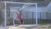 DiPasquale lays out for a block in penalty kicks (Photo by TCNJ Sports Information Desk)