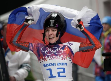 Elena Nikitina seen here celebrating her bronze medal during the women's skeleton competition at the 2014 Winter Olympics (Photo by the Associated Press/Michael Sohn)