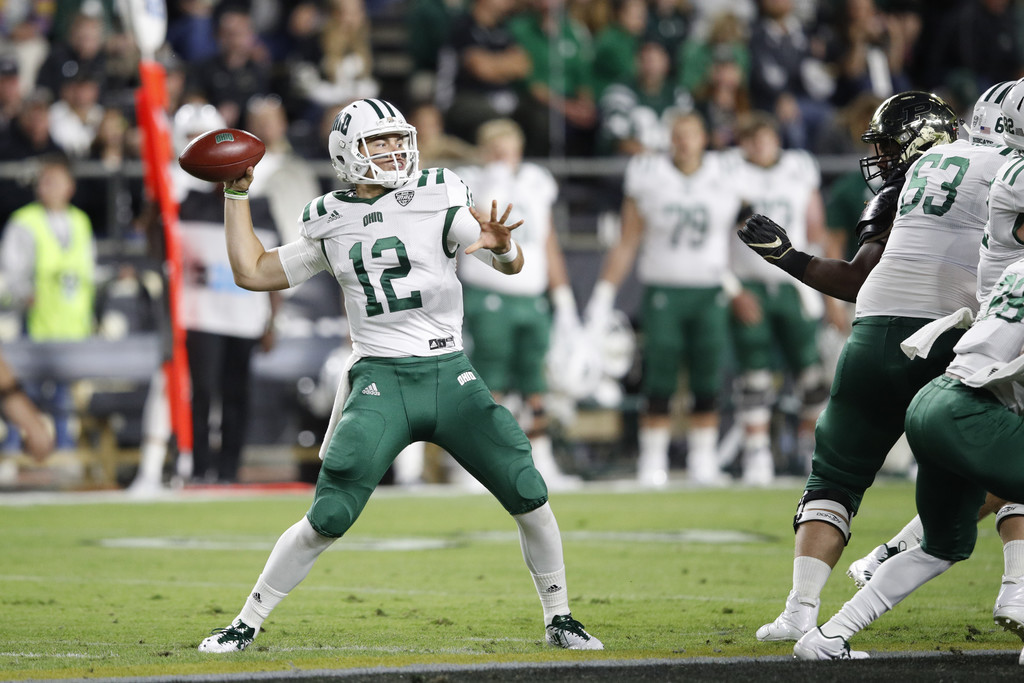 Ohio Bobcats quarterback Nathan Rourke attempts a pass against the Purdue Boilermakers