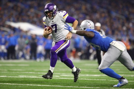 Minnesota Vikings quarterback Case Keenum rushing for a touchdown against the Detroit Lions on Thanksgiving Day (Getty Images)