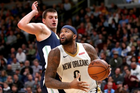 New Orleans Pelicans center DeMarcus Cousins being defended by Denver Nuggets center Nikola Jokić (Getty Images)