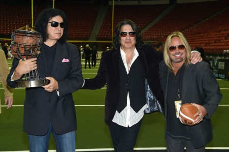 Gene Simmons stands with Paul Stanley and Vince Neil on an Arena Football League field (Getty Images)