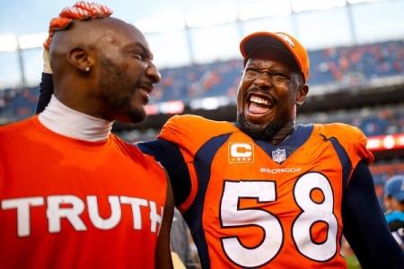 Denver Broncos star Von Miller laughing with Aqib Talib (Getty Images)