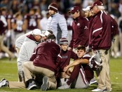 Mississippi State Bulldogs quarterback Nick Fitzgerald on the field after being injured (Getty Images)