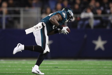 Philadelphia Eagles linebacker Nigel Bradham picks up a fumble and scores against the Dallas Cowboys (Getty Images)