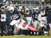 Penn State Nittany Lions running back Saquon Barkley breaks a tackle by a Nebraska defender (Getty Images)