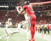 Atlanta Falcons wide receiver Julio Jones attempting to make a reception over a New Orleans Saints player (Photo by Action Sports and News)