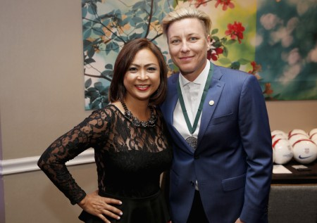Abby Wambach standing next to Cynthia Halelamien at the 32nd annual Great Sports Legends Dinner to Benefit the Miami Project/Buoniconti Fund to Cure Paralysis (Getty Images)