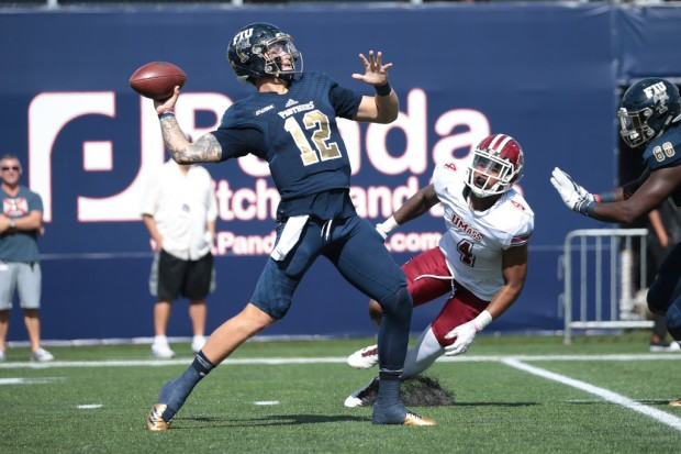 FIU Panthers quarterback Alex McGough attempts a pass against the Massachusetts Minutemen