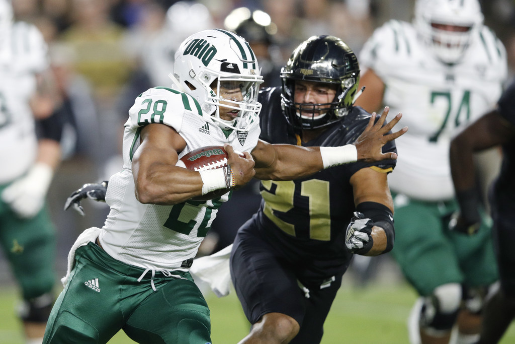 Ohio Bobcats running back Dorian Brown rushing the ball against the Purdue Boilermakers