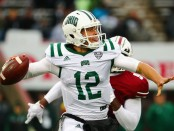 Ohio Bobcats quarterback Nathan Rourke attempting a pass against the UMass Minutemen