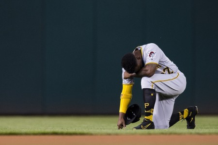 Pittsburgh Pirates outfielder Andrew McCutchen prays in the outfield (Getty Images)