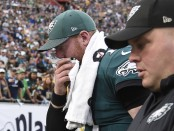 Philadelphia Eagles quarterback Carson Wentz walks to the locker room after suffering a potential season-ending torn ACL injury (Getty Images)