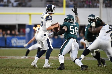 Philadelphia Eagles defensive end Chris Long about to cause Los Angeles Rams quarterback Jared Goff to fumble the ball (Getty Images)