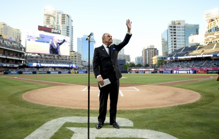 Legendary sports broadcaster Dick Enberg waves to the San Diego Padres crowd prior to his final home game in 2016 (Getty Images)