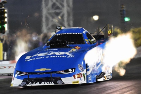 John Force racing down the track (Photo by John Force Racing)